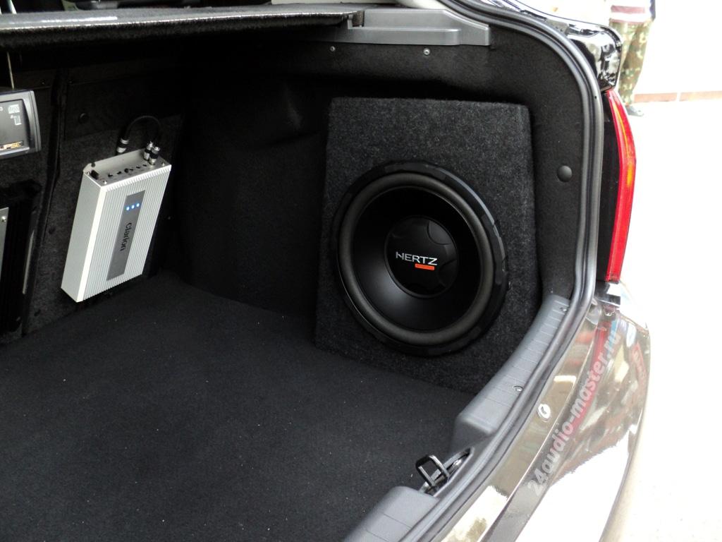 установка сабвуфера в обшивку багажника